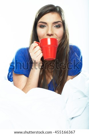 woman drink coffee in bed. Beautiful young model portrait.