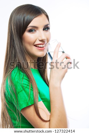 Woman drink water, hold glass standing against white background - stock photo