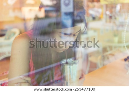 woman drinking a coffee in cafe coffee - stock photo