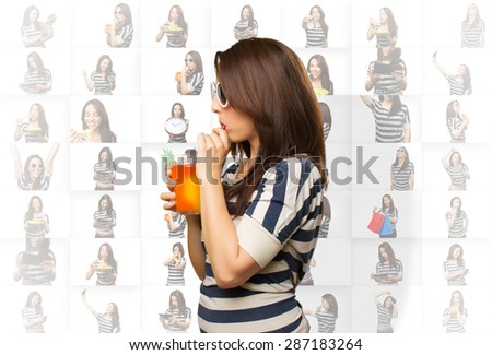 Woman drinking a juice with a red straw - stock photo