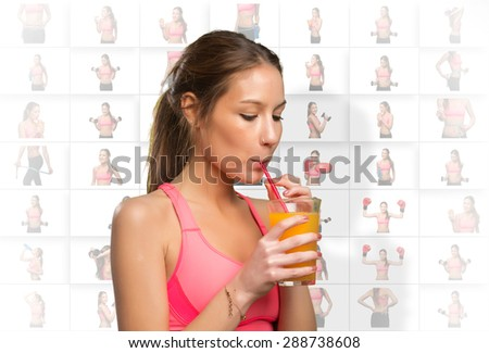 Woman drinking a orange juice with a red straw - stock photo