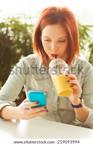 Woman Drinking a Smoothie - stock photo