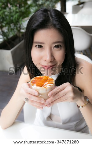 woman drinking coffee in the morning at coffee shop - stock photo