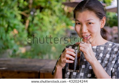 woman drinking cold beverage