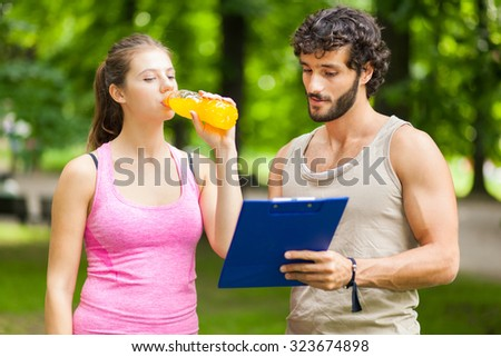 Woman drinking energy drink after running - stock photo