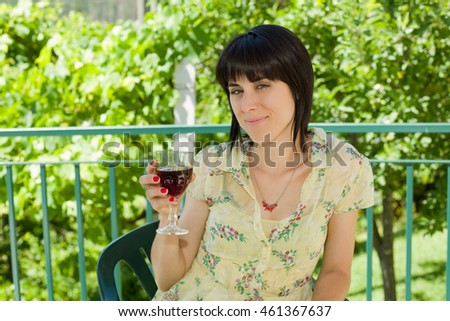 woman drinking red wine in a vineyard, outdoor