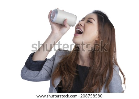 Woman drinking / showing blank can. Excited happy screaming girl holding energy drink or other drink. Asian / Caucasian female model on white background. - stock photo