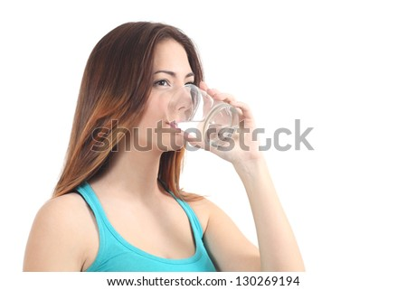 Woman drinking water from a glass on a white isolated background - stock photo