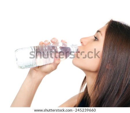 Woman drinking water from plastic bottle  isolated on a white background - stock photo