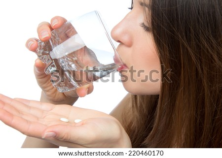 Woman drinking water headache hand take pill medicine tablet and glass isolated on a white background - stock photo