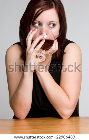 Woman Drinking Wine - stock photo