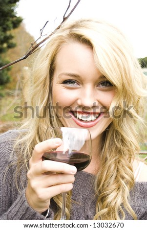woman drinking wine at the vineyard