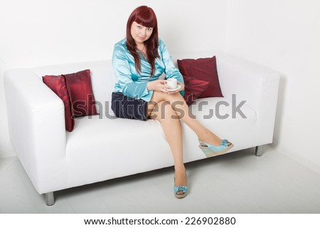 woman drinks coffee - stock photo