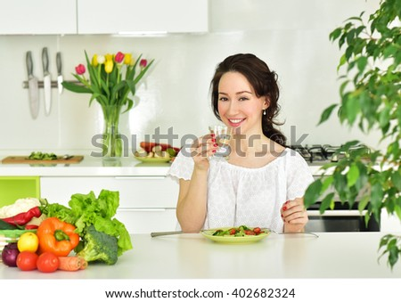 Woman Drinks water in kitchen. Healthy eating lifestyle concept. Dieting concept. Healthy Food - stock photo