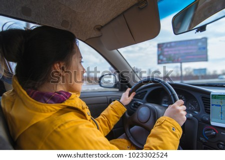 woman drive car in cold winter weather