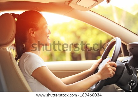 woman driver driving a car - stock photo