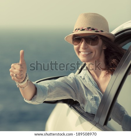 Woman driver in the car. Summer vacation concept - stock photo