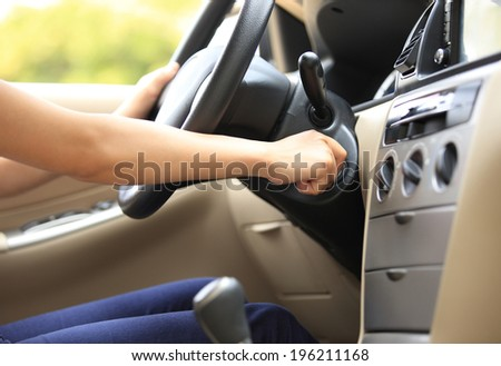 woman driver starting the car engine - stock photo