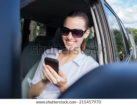 Woman driver using cellphone in the car. - stock photo
