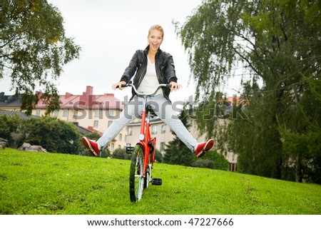 Woman driving a bike in the park