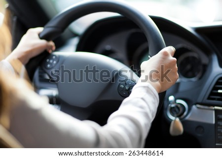 Woman driving her car - stock photo