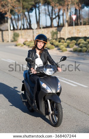 woman driving on scooter  - stock photo