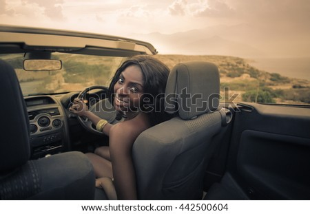 Woman driving on vacation - stock photo