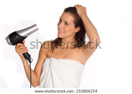 Woman dry her hair