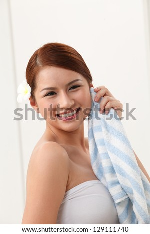 Woman drying off with towel - stock photo