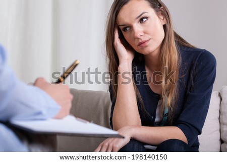Woman during first meeting with psychotherapist, horizontal - stock photo