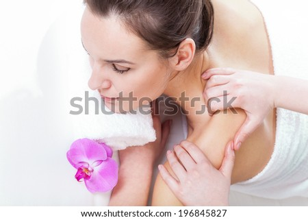 Woman during massage in spa on isolated background