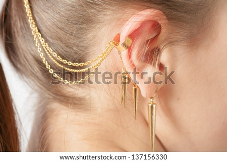 Woman ear with earring white background - stock photo