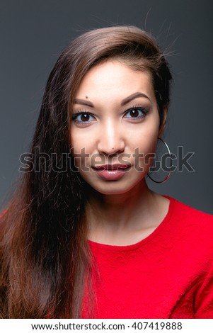 woman Eastern India, the Arab or Mongoloid mixed race in red dress on grey studio background - stock photo