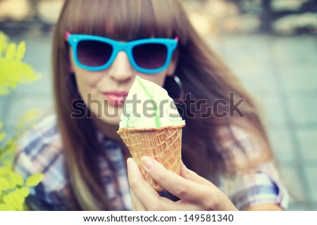 Woman eating a delicious pistachio ice cream - stock photo