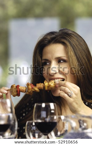 Woman eating a kebab