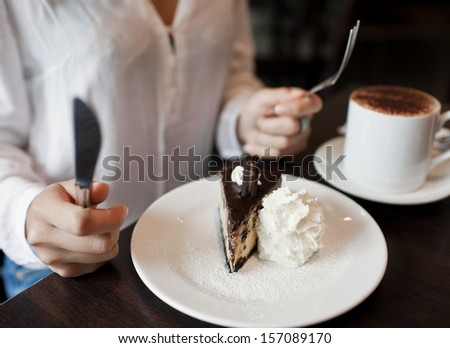 woman eating a piece of cake - stock photo