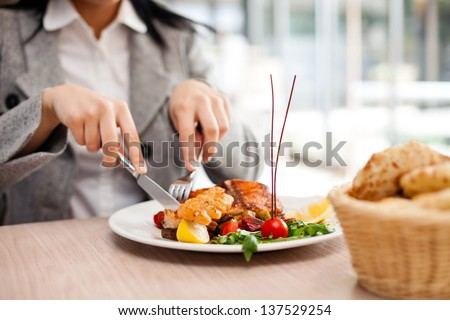 Woman eating at restaurant