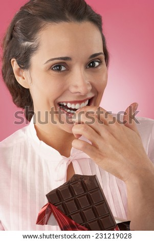 Woman Eating Chocolate - stock photo