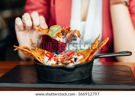 Woman eating delicious food in closeup