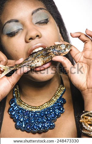 Woman eating fish - stock photo