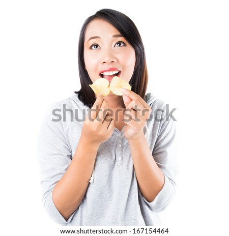 Woman  eating potato chips on white background