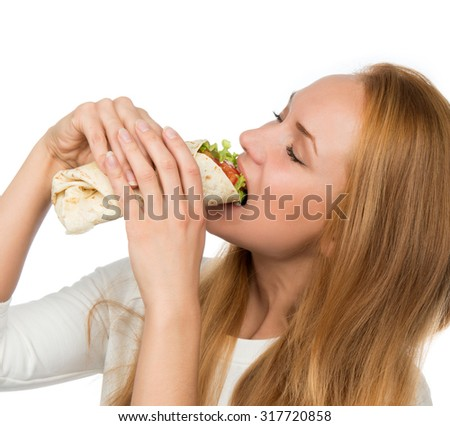 Woman eating tasty unhealthy burger twisted sandwich in hands hungry getting ready to eat isolated on a white background Fast food concept - stock photo
