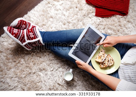 Woman eating traditional christmas cookies - stock photo