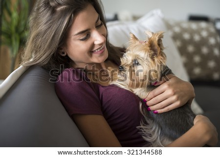 Woman embracing her little puppy - stock photo