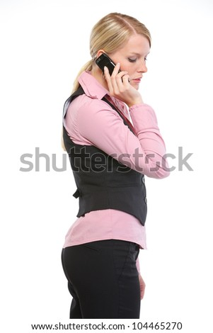 Woman employee speaking mobile phone. Side view - stock photo