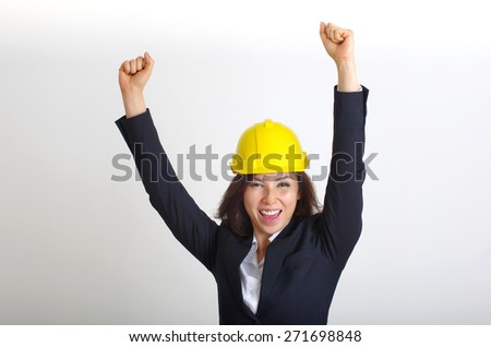 woman engineer happy and hand up - stock photo
