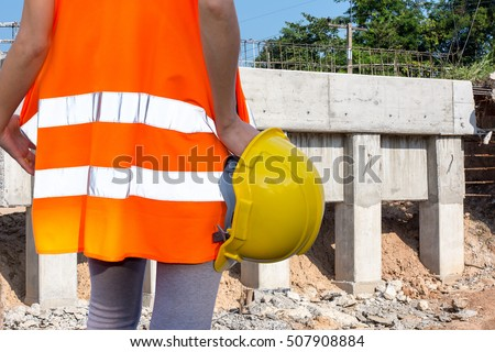 Woman engineer in Bridge construction.
