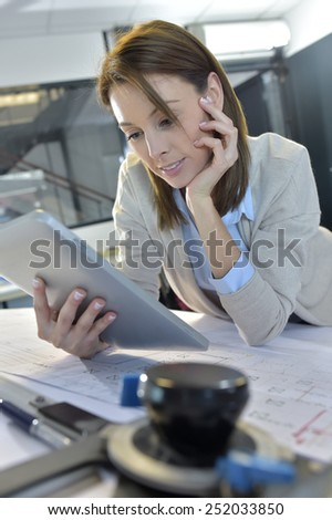 Woman engineer working on digital tablet