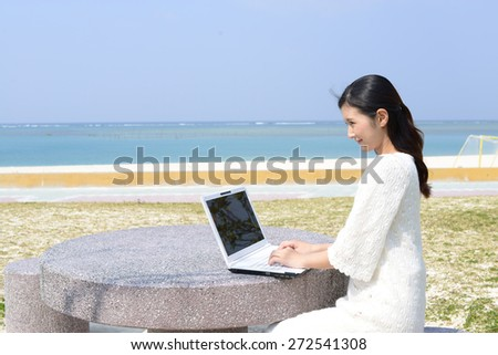 Woman enjoy personal computer - stock photo