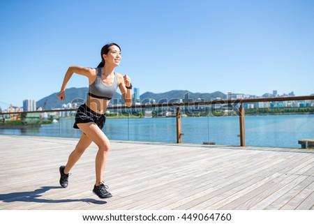 Woman enjoy running at outdoor - stock photo